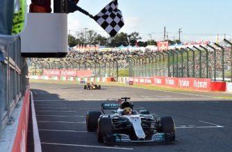 Mercedes' British driver Lewis Hamilton crosses the finish line to win the Formula One Japanese Grand Prix at Suzuka on October 8, 2017. / AFP PHOTO / POOL / KAZUHIRO NOGI
