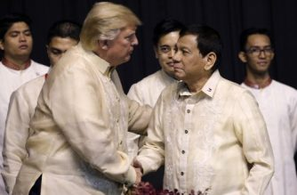 US President Donald Trump shakes hands with Philippines President Rodrigo Duterte during a special gala celebration dinner for the Association of Southeast Asian Nations (ASEAN) in Manila on November 12, 2017. World leaders arrive in the Philippines' capital for two days of summits beginning on November 13.  / AFP PHOTO / POOL / ATHIT PERAWONGMETHA