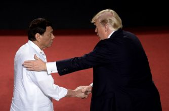 Philippine President Rodrigo Duterte shakes hands with US President Donald Trump (R) during the 31st Association of Southeast Asian Nations (ASEAN) Summit in Cultural Center of the Philippines (CCP) in Manila on November 13, 2017. World leaders are in the Philippines' capital for two days of summits.  / AFP PHOTO / AFP PHOTO AND POOL / NOEL CELIS