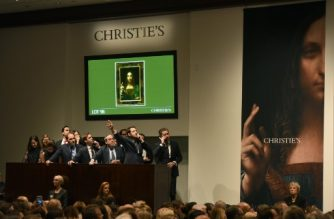 "Christie's employees take bids for Leonardo da Vinci's ""Salvator Mundi"" at Christie's New York on November 15, 2017. A 500-year-old work of art depicting Jesus Christ, believed to be the work of Renaissance master Leonardo da Vinci, sold in New York on Wednesday for $450.3 million setting a new art auction record, Christie's said. ""Salvator Mundi,"" which the auction house dates back to around 1500, sold after 18 minutes of frenzied bidding in a historic sale, the star lot of the November art season in the US financial capital.  / AFP PHOTO / TIMOTHY A. CLARY"