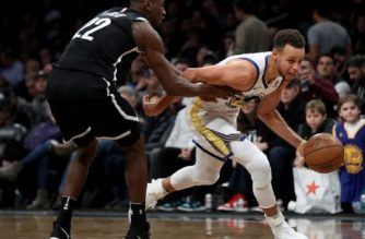 NEW YORK, NY - NOVEMBER 19: Stephen Curry #30 of the Golden State Warriors drives down the court against Caris LeVert #22 of the Brooklyn Nets in the third quarter during their game at Barclays Center on November 19, 2017 in the Brooklyn borough of New York City. NOTE TO USER: User expressly acknowledges and agrees that, by downloading and or using this photograph, User is consenting to the terms and conditions of the Getty Images License Agreement.   Abbie Parr/Getty Images/AFP