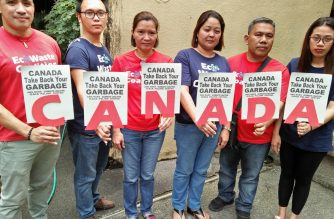 Members of environmental groups pose with placards calling on Canada Prime Minister Justin Trudeau to take back the garbage from Canada they said was illegally dumped in the Philippines. /From EcoWaste website/