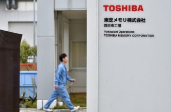 (FILES) This file photo taken on October 13, 2017 shows the logo of Toshiba Memory Corp. at an entrance of the company's Yokkaichi plant in Yokkaichi, Mie prefecture on October 13, 2017. / AFP PHOTO / Kazuhiro Nogi