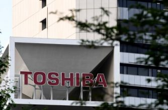 Toshiba corp logo is seen on the top of a building at the company's headquarters in Tokyo on June 23, 2017. AFP PHOTO / Toshifumi Kitamura