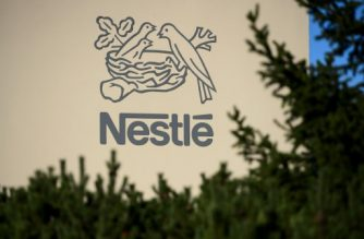 A logo of the world's leading food industry group Nestle is seen on October 9, 2014 at the group's Research Center in Vers-chez-les-Blanc above Lausanne.  AFP PHOTO / FABRICE COFFRINI / AFP PHOTO / FABRICE COFFRINI