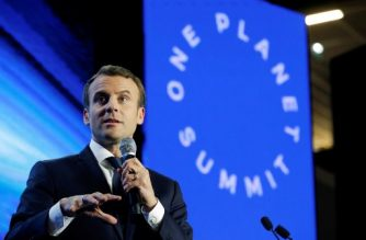 French President Emmanuel Macron delivers a speech during the 'Tech for Planet' event at the 'Station F' start-up campus ahead of the One Planet Summit in Paris on December 11, 2017.  / AFP PHOTO / POOL / PHILIPPE WOJAZER