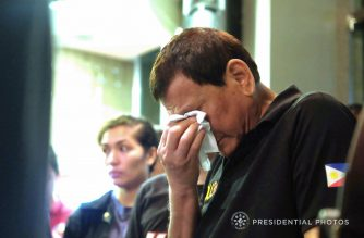 President Rodrigo Duterte breaks down in tears during his visit to kin of the Davao mall fire victims. /Presidential photo/