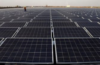This photo taken on December 11, 2017 shows a general view of a floating solar power plant in Huainan, a former coal-mining region, in China's eastern Anhui province. / AFP PHOTO / - / China OUT