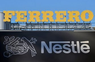 (COMBO) This combination of pictures created on January 10, 2018, shows the logo of Ferrero at the top of the Ferrero plant in Alba taken on May 17, 2014 ; and the logo of the world's leading food industry group Nestle taken on October 9, 2014 at the group's Research Center in Vers-chez-les-Blanc above Lausanne. Italy's Ferrero is closing in on a $2.8-billion deal for Nestle's US confectionary business, Bloomberg said on January 10, 2018, amid signs a deal could be completed by January 14. / AFP PHOTO / GIUSEPPE CACACE AND Fabrice COFFRINI