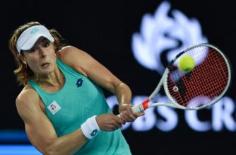 (FILES) This file photo taken on January 17, 2018 shows France's Alize Cornet playing a backhand return to Germany's Julia Goerges during their women's singles second round match on day three of the Australian Open tennis tournament in Melbourne. Frenchwoman Alize Cornet was placed under a disciplinary investigation on January 24, 2018, after missing three random drug tests, the French tennis federation announced (FFT) on January 24, 2018.  / AFP PHOTO / PETER PARKS / -- IMAGE RESTRICTED TO EDITORIAL USE - STRICTLY NO COMMERCIAL USE --