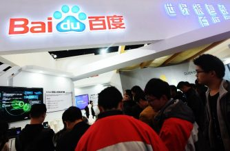 This photo taken on December 4, 2017 shows people visiting the Baidu booth during the 4th World Internet Conference in Wuzhen in China's eastern Zhejiang province.  The conference is held in Wuzhen from December 3 to 5. / AFP PHOTO / - / China OUT
