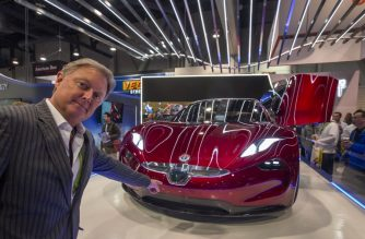 Henrik Fisker, founder, Chairman and CEO of Fisker Inc., speaks next to a Fisker EMotion all-electric vehicle that uses LiDAR technology at CES in Las Vegas, Nevada, January 9, 2018. / AFP PHOTO / DAVID MCNEW