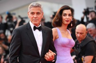 "(FILES) In this file photo taken on September 2, 2017 US actor and director George Clooney and his wife Amal attend the premiere of the movie ""Suburbicon"" presented out of competition at the 74th Venice Film Festival at Venice Lido.  Hollywood star George Clooney and his human rights lawyer wife Amal on February 19, 2018 pledged $500,000 to help fund a US student march on Washington demanding gun control reforms.The ""March for Our Lives"" is scheduled to take place on March 24, with sister rallies planned across the country. It comes after a 19-year-old armed with a semi-automatic rifle killed 17 people at a high school in Parkland, Florida last week.  / AFP PHOTO / Tiziana FABI"