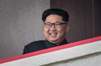 (FILES) This file photo taken on May 10, 2016 shows North Korean leader Kim Jong-Un watching a military parade and mass rally on Kim Il-Sung Square in Pyongyang. North Korea's planned military parade on the eve of the South's Winter Olympics is a carefully calculated move to use the global spotlight on the peninsula to reassert its military power, analysts say. / AFP PHOTO / Ed JONES / TO GO WITH NKorea-SKorea-politics-Oly-diplomacy,FOCUS