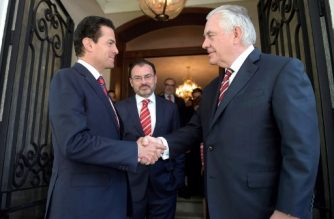 """This handout picture released by the Mexican presidency shows Mexican President Enrique Pena Nieto (L) shaking hands with US Secretary of State Rex Tillerson (R), next to Mexican Foreign Minister Luis Videgaray (C), at the Los Pinos Residence in Mexico City on February 2, 2018.  US Secretary of State Rex Tillerson is on an official two-day visit to Mexico as part of a tour of Latin America countries. / AFP PHOTO / Mexican Presidency / HO / RESTRICTED TO EDITORIAL USE-MANDATORY CREDIT """"AFP PHOTO/MEXICAN PRESIDENCY/HO"""" NO MARKETING NO ADVERTISING CAMPAIGNS-DISTRIBUTED AS A SERVICE TO CLIENTS-GETTY OUT"""