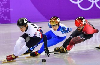 USA's J.R. Celski (L), Canada's Charles Hamelin and Russia's Semen Elistratov (C) take part in the men's 1,500m short track speed skating semi-final event during the Pyeongchang 2018 Winter Olympic Games, at the Gangneung Ice Arena in Gangneung on February 10, 2018. / AFP PHOTO / Mladen Antonov
