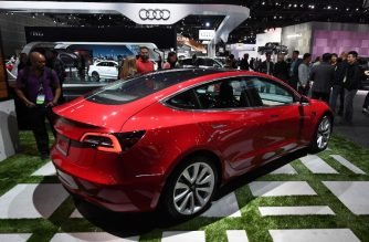 Exterior of the new Tesla Model 3, at the 2017 LA Auto Show in Los Angeles, California on November 29, 2017. / AFP PHOTO / Mark RALSTON