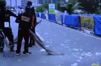 Members of INC's SCAN, other INC members take to Manila streets to clean up after Worldwide Walk to Fight Poverty